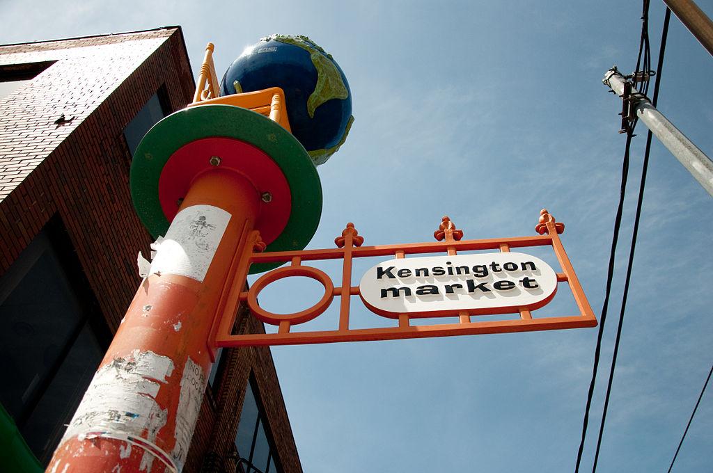 1024px-Kensington_Market_Sign_Toronto_2010
