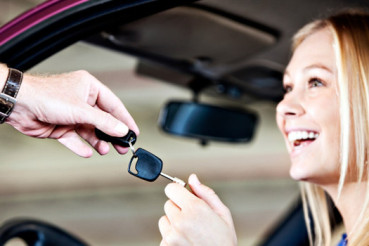 Happy blonde babe is given keys to car